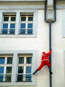 Santa climbing drain pipe